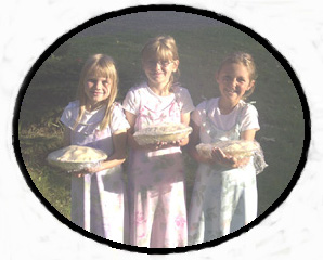 Girls holding pies