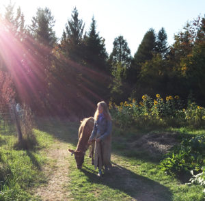 LaynaMae and Jacqueline taking a late afternoon walk outside the garden